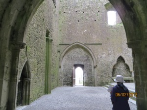 Cashel Cathedral ruins with tourist
