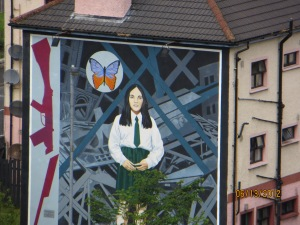 "A building mural in memory of a young girl killed during the ""Troubles"""
